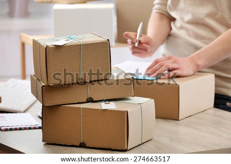 Woman working in post office - stock photo