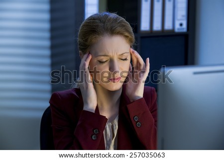 Woman working in the office at night - stock photo