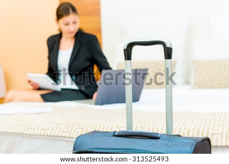 woman working on a business trip at the hotel - stock photo