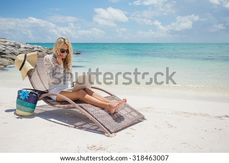 Woman working on the beach - stock photo