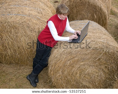 woman working wireless on her computer in the country - stock photo