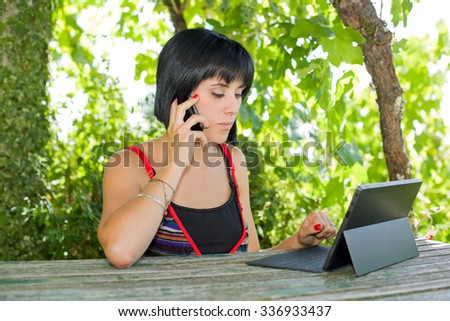 woman working with a tablet pc, outdoor - stock photo