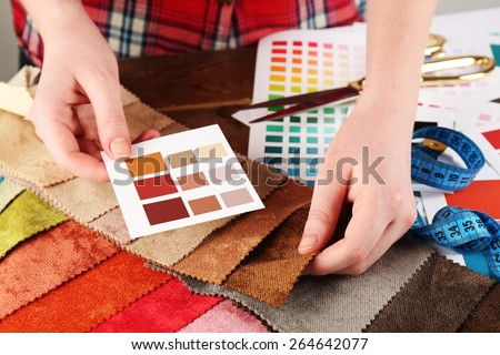 Woman working with scraps of colored tissue and palette close up - stock photo