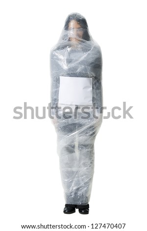 Woman wrapped in bubble wrap with blank sign - stock photo