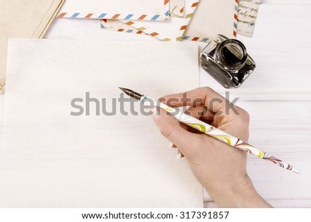 Woman writing a letter, copy space - stock photo
