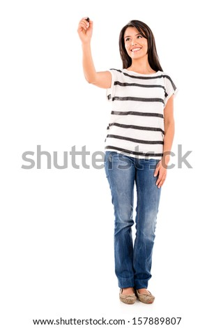 Woman writing and holding a pen - isolated over white background  - stock photo