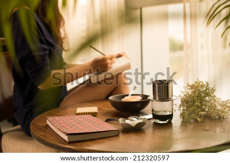 Woman writing down her ideas - stock photo