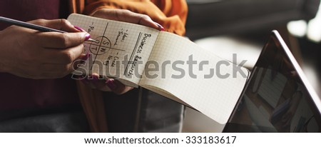 Woman Writing Notepad Notes SWOT Business Concept - stock photo