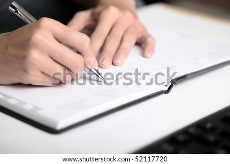 "Woman writing ""to do list"" - stock photo"