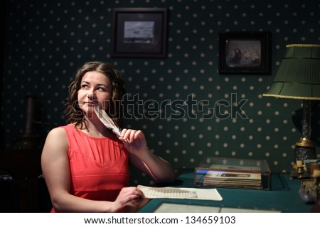 woman wrote a romantic letter in a vintage style - stock photo