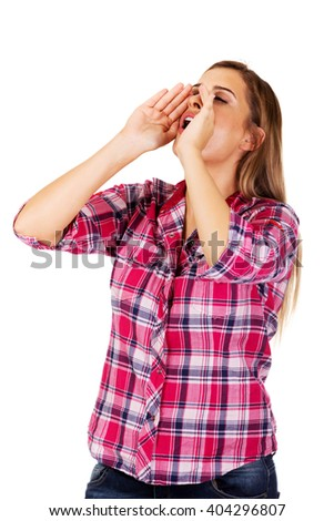 Woman yelling using her hands as megaphone - stock photo