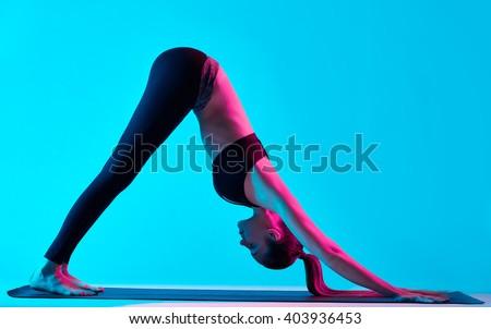 woman yoga exercices Adho Mukha Svanasana - stock photo
