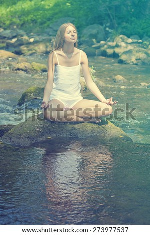 Woman Yoga Meditation Nature Water River - stock photo