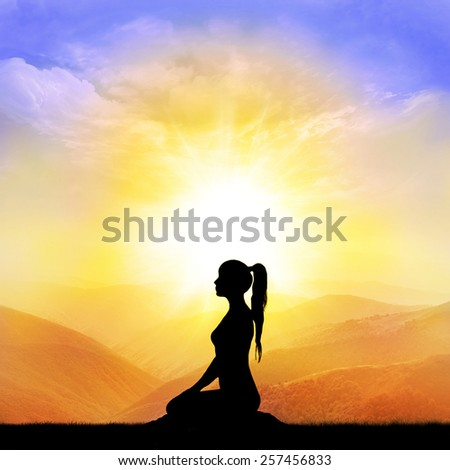 Woman yoga silhouette in the mountain - stock photo