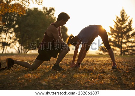 Woman yoga trainer demonstrating to student different positions - stock photo