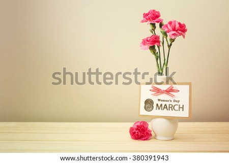 Womans day March 8th card with pink carnations - stock photo