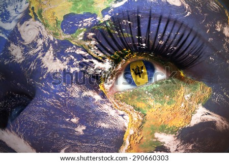 womans face with planet Earth texture and barbados flag inside the eye. Elements of this image furnished by NASA. - stock photo