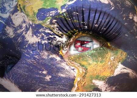 womans face with planet Earth texture and nepal flag inside the eye. Elements of this image furnished by NASA. - stock photo
