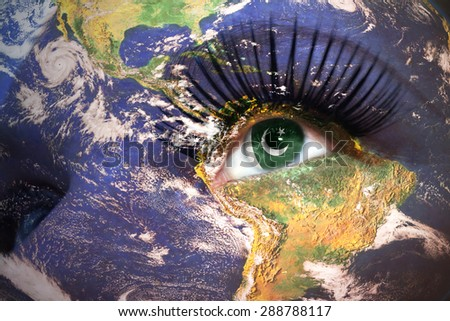 womans face with planet Earth texture and pakistani flag inside the eye. Elements of this image furnished by NASA. - stock photo
