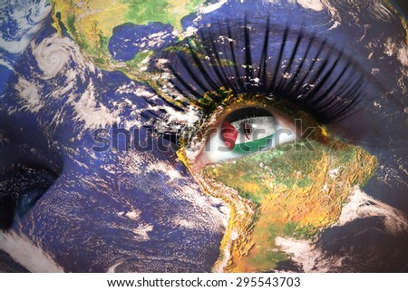 womans face with planet Earth texture and Sahrawi Arab Democratic Republic flag inside the eye. Elements of this image furnished by NASA. - stock photo