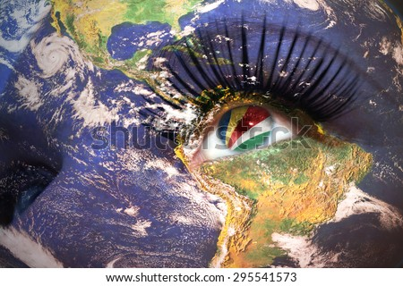 womans face with planet Earth texture and seychelles flag inside the eye. Elements of this image furnished by NASA. - stock photo