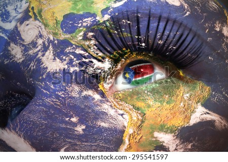 womans face with planet Earth texture and South Sudan flag inside the eye. Elements of this image furnished by NASA. - stock photo