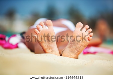 womans feet on the beach. holiday concept near sea. - stock photo
