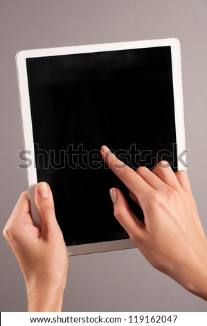 Womans hands holding a tablet pc - stock photo