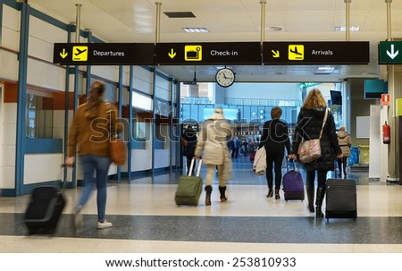 Women Airline Passengers in an Airport - stock photo