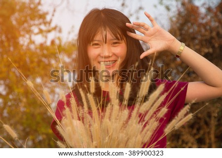 Women and flower grass beautiful in the summer  - stock photo