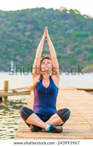 women are concentrated in yoga at dawn - stock photo