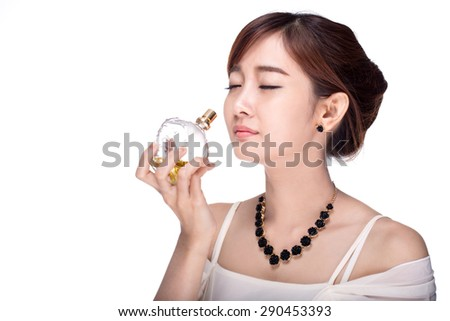 Women are inhaled perfumes on a white background. - stock photo