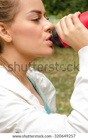 Women athletes drink water - stock photo