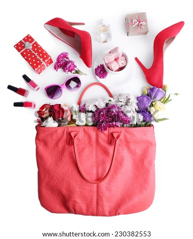 Women bag stuff top view isolated on white - stock photo