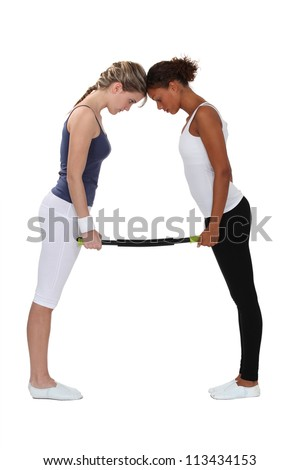 Women bending an aerobic fitness bar - stock photo