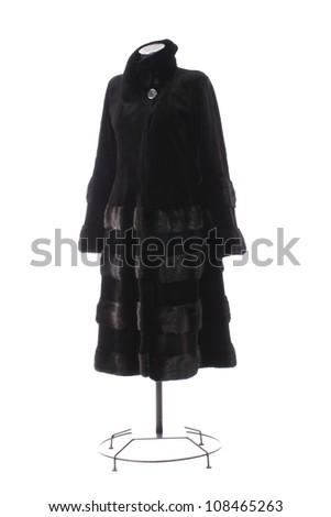Women black fur coat on white background - stock photo
