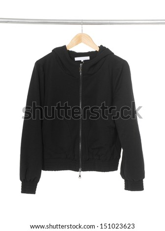 Women black jacket hanging on hanger on white background - stock photo