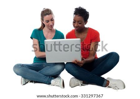 Women buffering funny video on laptop - stock photo