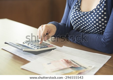 women calculating the money will be used to pay the loan. - stock photo