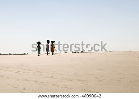 Women carrying goods on their heads. Madagascar - stock photo