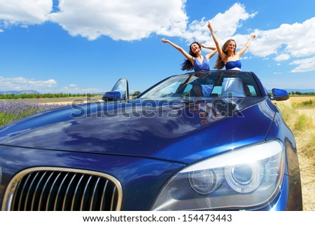 women dance in car - stock photo