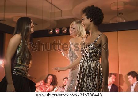 Women dancing at a nightclub. - stock photo