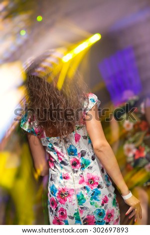 Women dancing at the night club. - stock photo