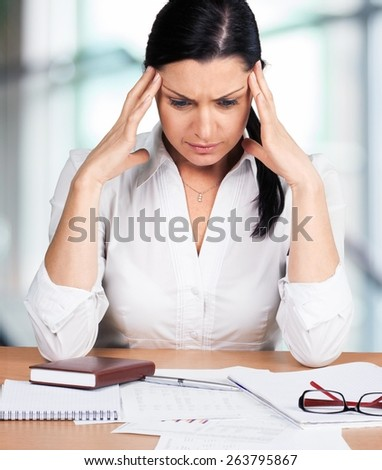 Women. Disappointed mature businessswoman thinking over something - stock photo