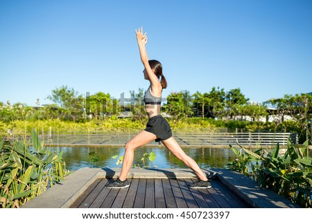 Women do stretching in park - stock photo