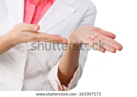 Women doctor holding medicine in hand.  All isolated on white background. - stock photo