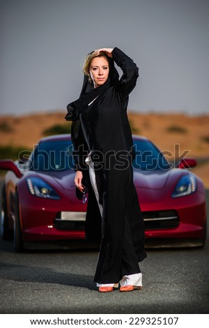 Women dressed middle eastern way poses on sunset. - stock photo
