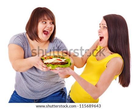Women eating hamburger. Isolated. - stock photo