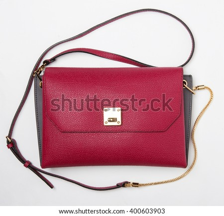 women elegant leather bag in pan isolated with shadows - stock photo