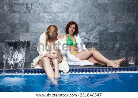Women enjoying wellness and spa swimming pool. - stock photo